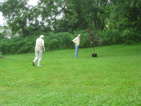 Mary Shanahan chooses a site for Robin Steussy's memorial tree at the Freitag Family Farm.