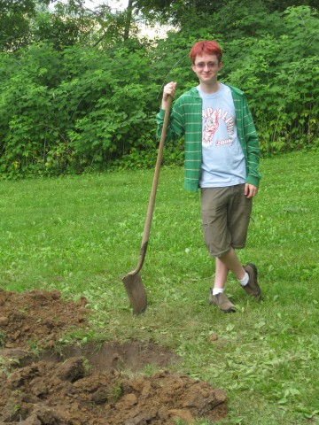 Thomas McFee also helps with planting.