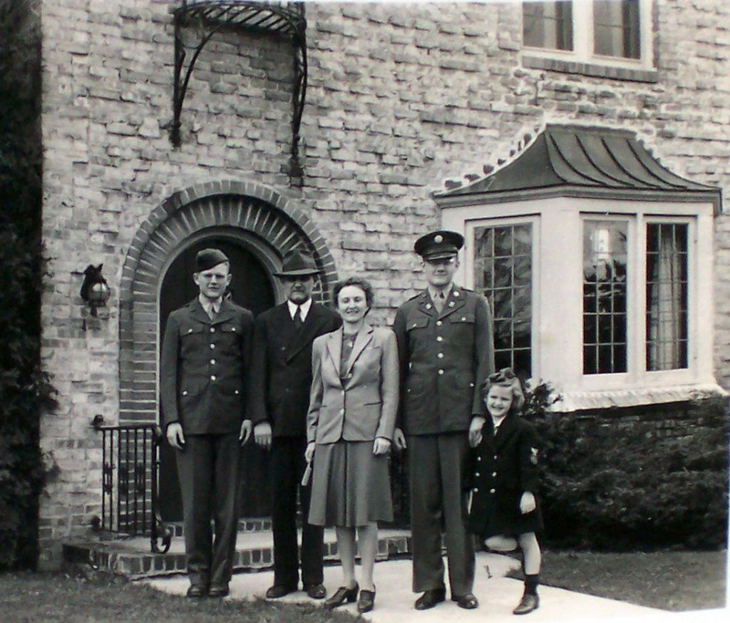 1943 photo of Calvin, Edwin, Helen, Robin and Mary Steussy. Nakoma Road house in background. Upper right window was Calvin's bedroom.